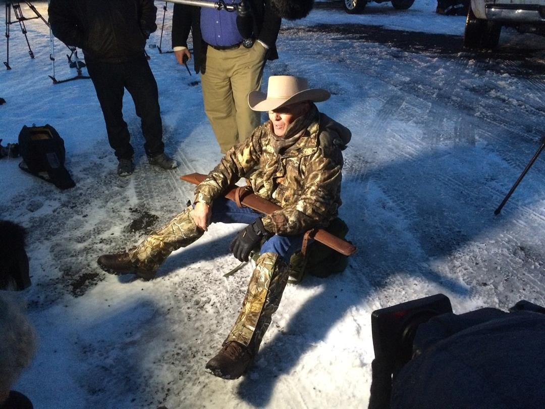 LaVoy Finicum sits on the ground in protest at the Malheur Wildlife Refuge. (photo credit: Jack Hannah/CNN)