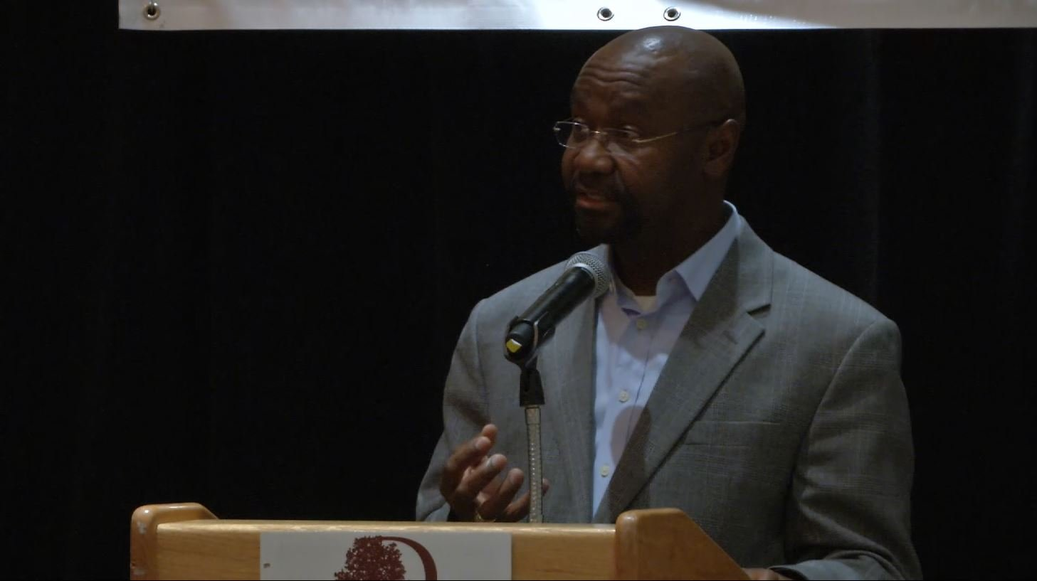 Speakers shared their perspective and stance on resettlement, including Wilmot Collins, who is himself a resettled refugee living in Montana. (MTN News photo)