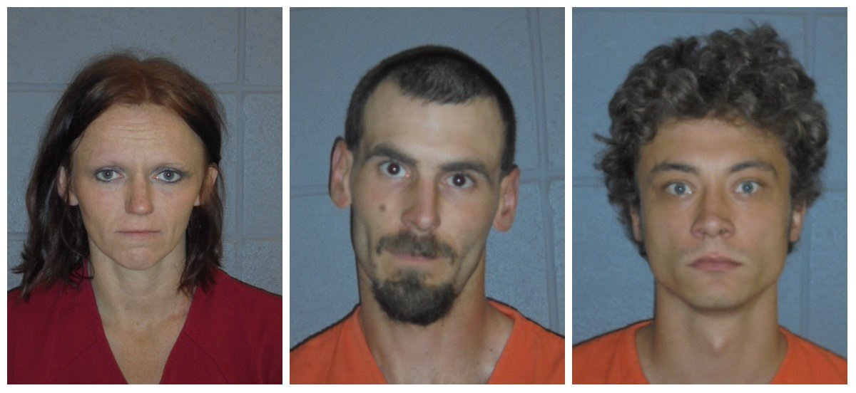 Christopher Hansen (center) and David Toman (right) were sentenced Thursday in connection with the murder of Wade Allen Rautio.