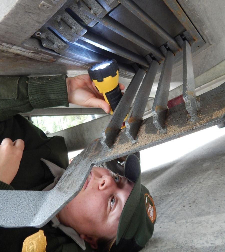 Park ranger inspects a boat for aquatic invasive species (Glacier National Park photo)