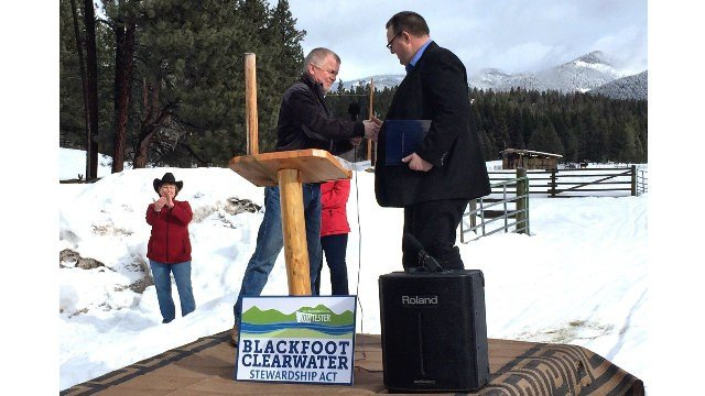 Ovando rancher Jim Stone thanks Sen. Jon Tester for Blackfoot Clearwater Stewardship Act during this morning's announcement. (Dennis Bragg photo)