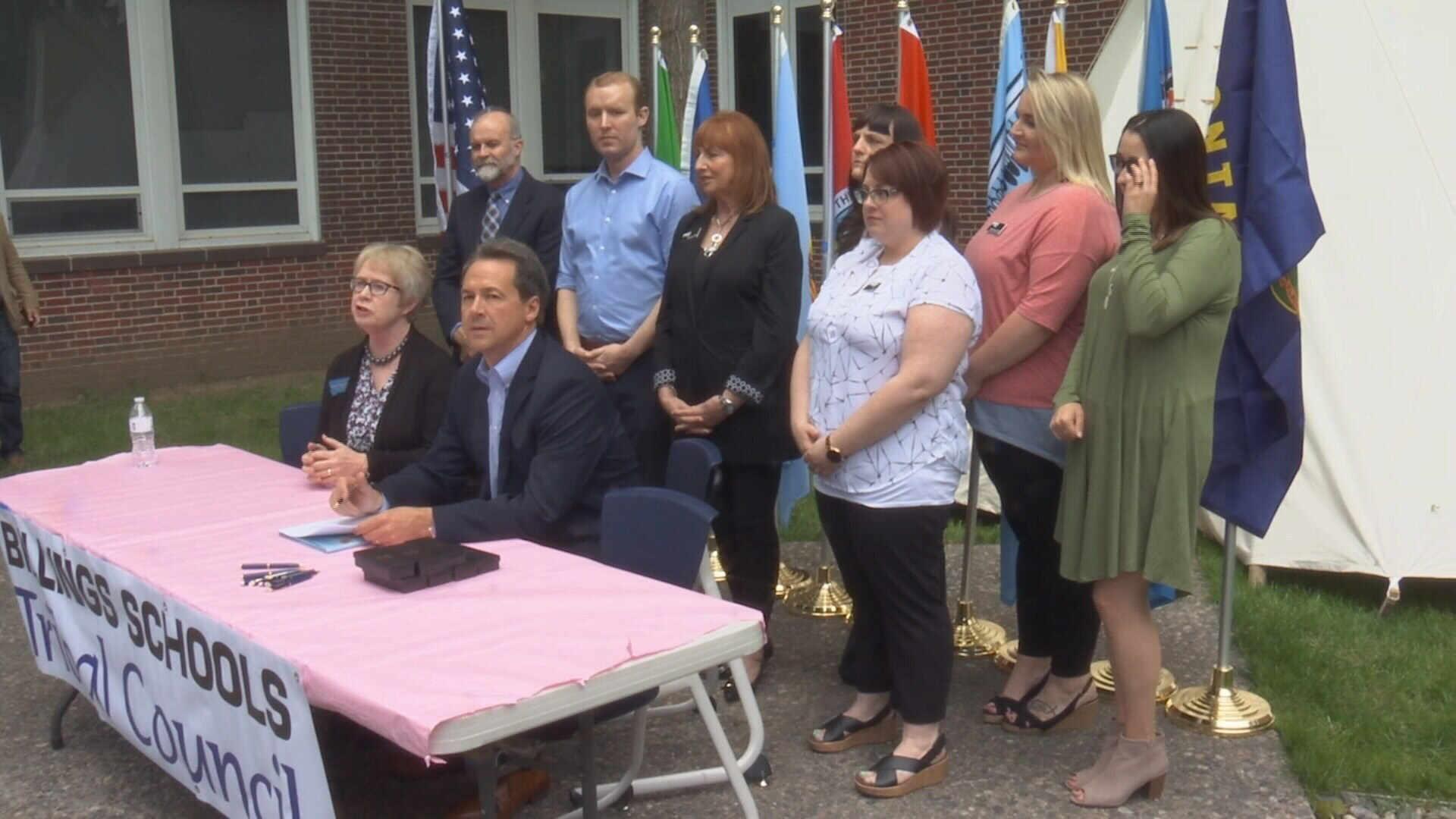 State Sen. MacDonald and Gov. Bullock seated at signing of SB 153. (MTN News photo)