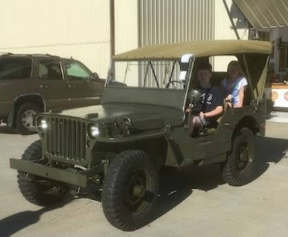 Jerry Scherer's grandchildren, 13-year-old Riley and 9-year-old Kaylie, recently sat in the nearly completely restored Jeep that will be presented to their grandfather this Saturday.