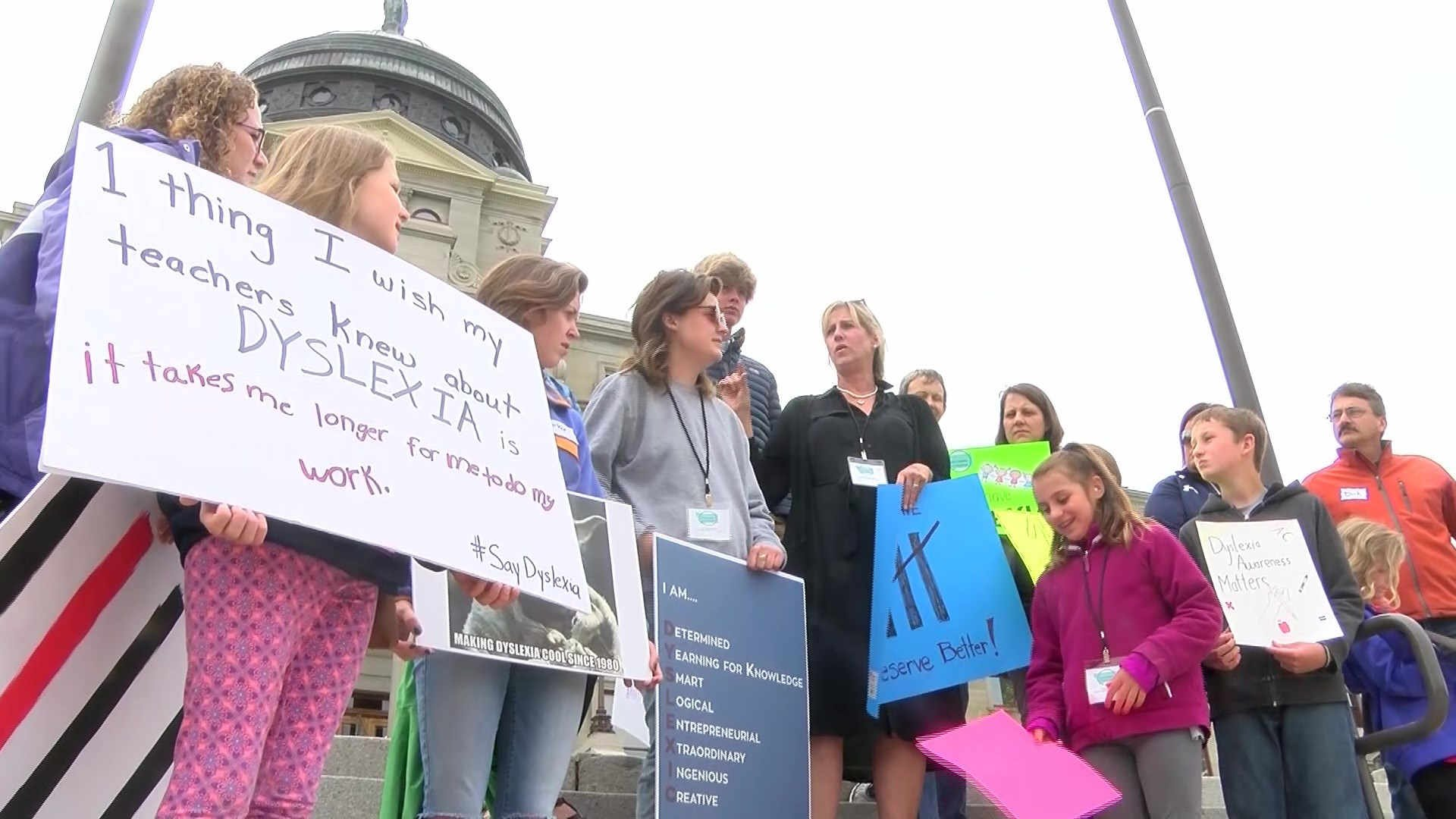 The activists carried signs showing their support for the dyslexia community. (MTN News photo)