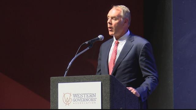 Interior Secretary Ryan Zine addressing the Western Governor's Association meeting in Whitefish. (MTN News photo)