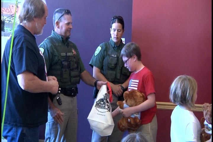 The Montana Hope Project and the Montana Highway Patrol presented 11-year-old David Reed with a check for a week-long Alaskan cruise. (MTN News photo)