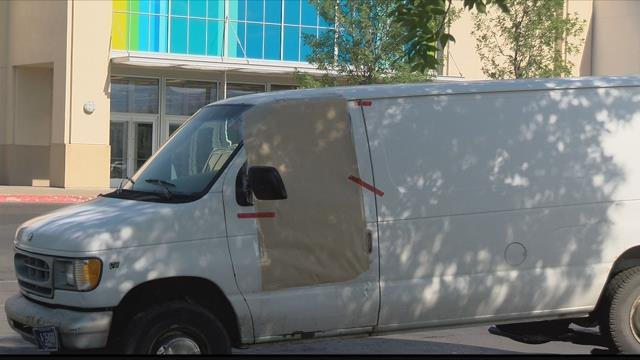 A body was found in a van in a parking lot along North Reserve Street. (MTN News photo)