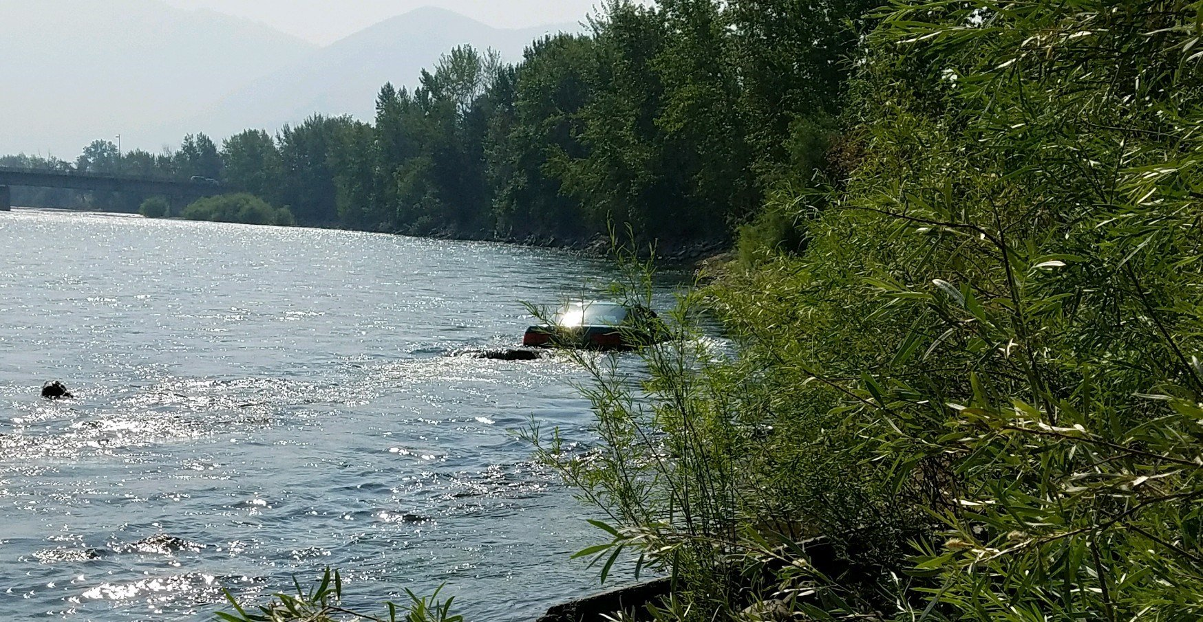 The pursuit ended with a vehicle in the Clark Fork River. (MTN News/Russ Thomas photo)