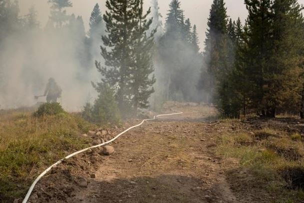 The Liberty fire is still burning between Arlee and Seeley Lake. (photo credit: Kari Greer)