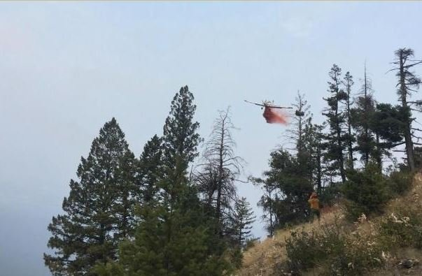 The Blue Bay fire is burning east of Polson along Highway 35. (photo credit: Mission Valley initial attack crew)
