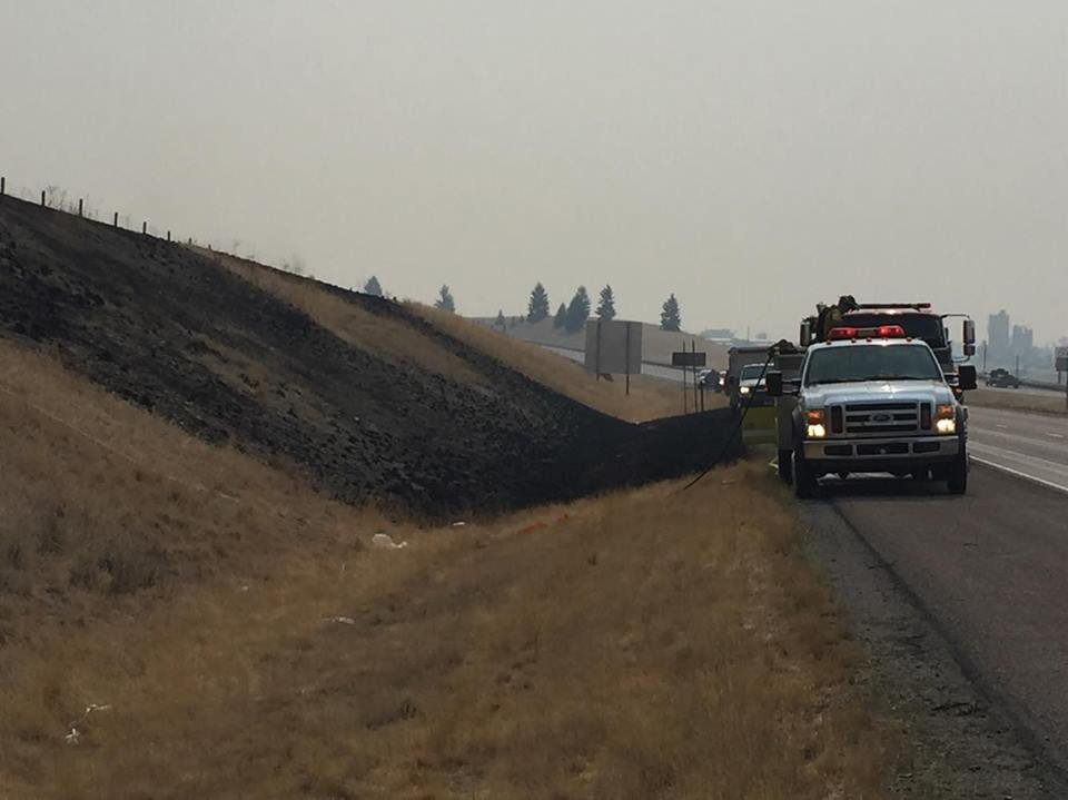 A quick moving grass fire broke out along I-90 west near Missoula on Wednesday morning. (MTN News/Don Fisher photo)
