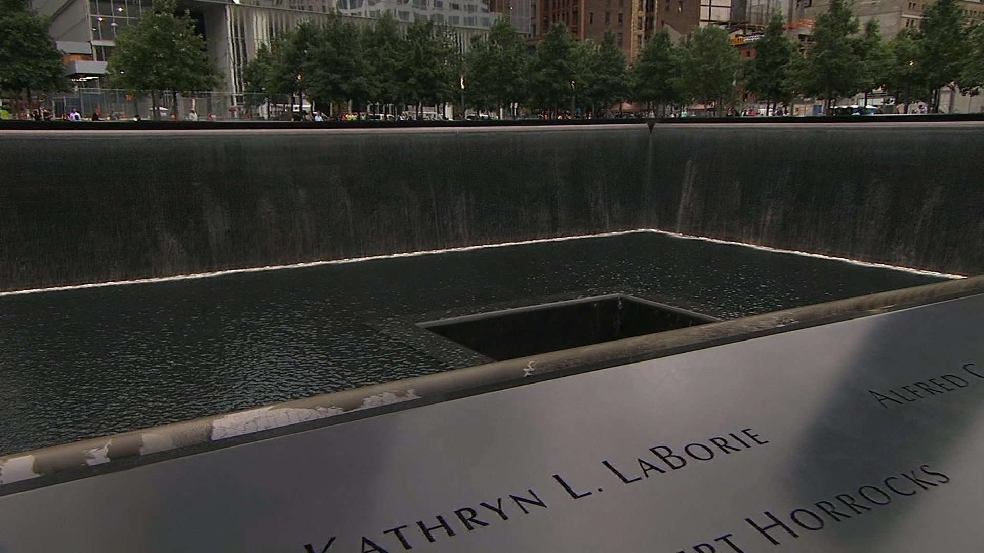 Water flows into one of two reflecting pools during the 13th anniversary of the September 11, 2001 attacks (POOL photo via CNN)
