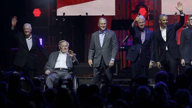 All five living former U.S. Presidents appeared at a Texas concert raising money for hurricane relief efforts. (photo credit: LM Otero/AP)