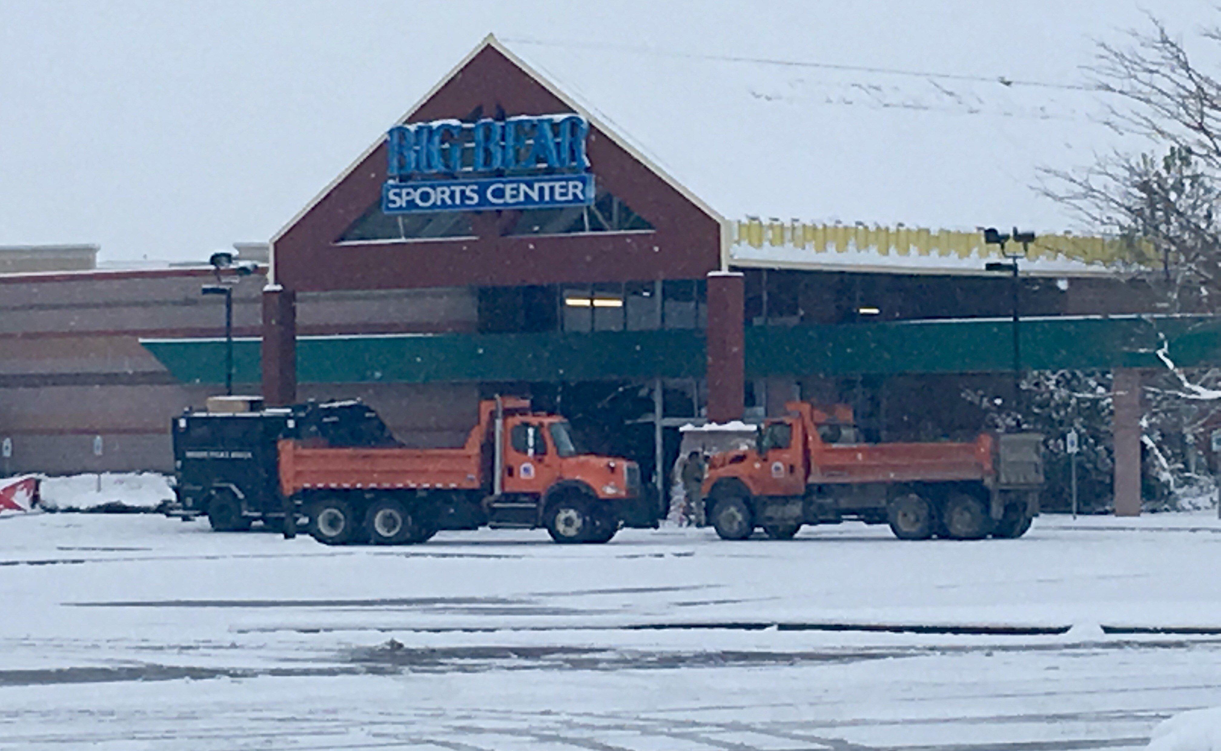 City dump trucks barricade the entrance of Big Bear Sports (MTN News photo)