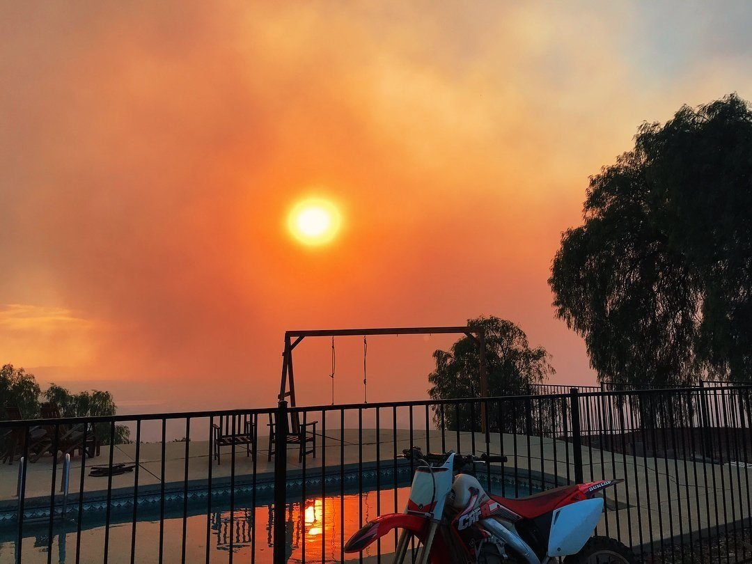 Smoke from wildfires in southern California form on the horizon early in the morning. (photo credit: Dena DePompa)