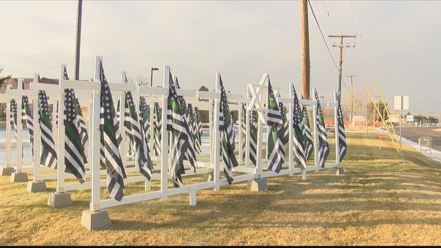 The 53 black, white and green flags are a memorial for the veterans we have lost to their own hands last year. (MTN News photo)