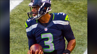 Seattle Seahawks quarterback Russell Wilson (Cropped Photo: Mike Morris / CC BY-SA 2.0 )
