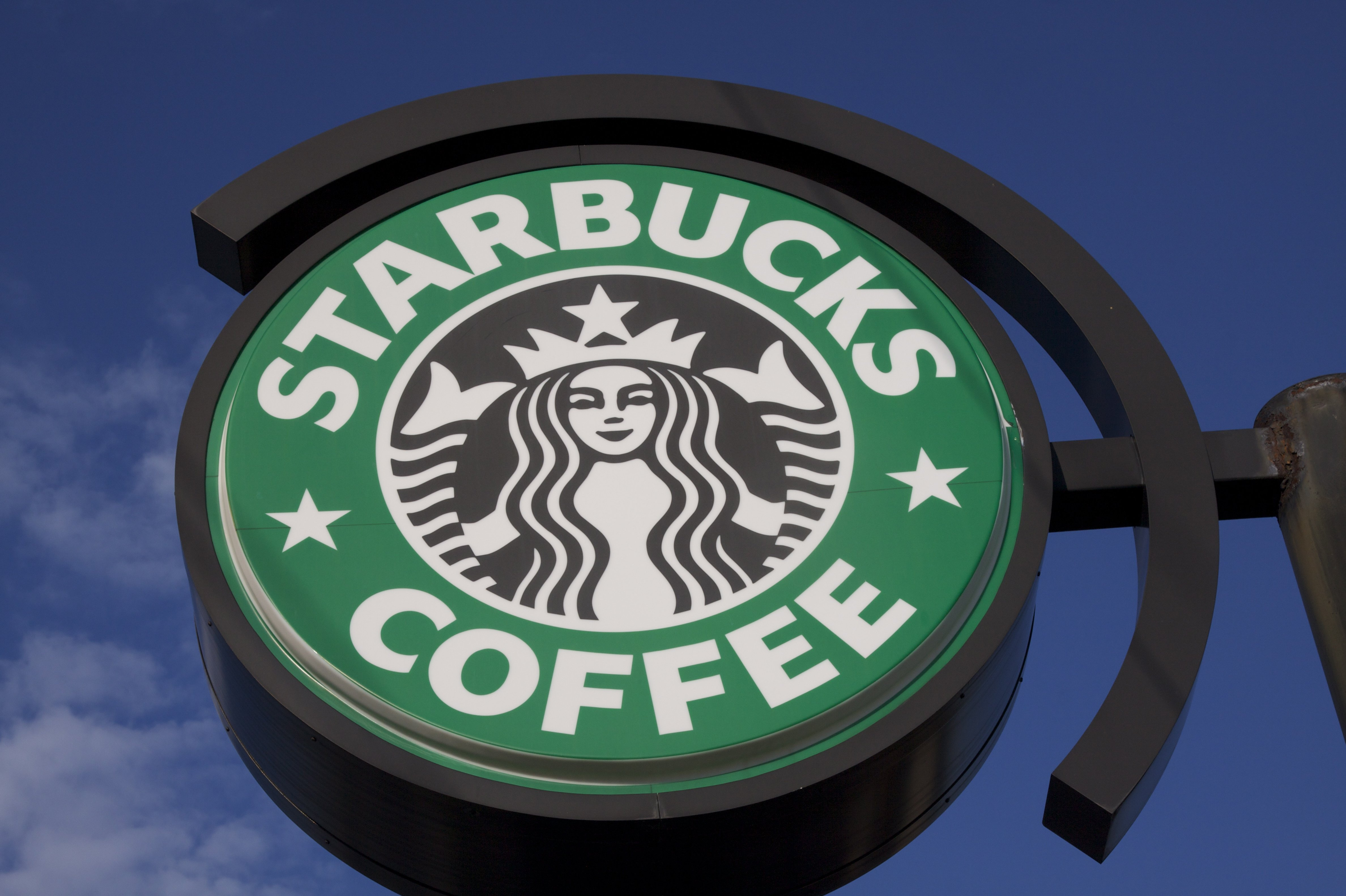 Starbucks says it will close its 8,000 company-owned stores in the US on May 29 to educate employees about racial bias. (Source: Ferre' Dollar/CNN)