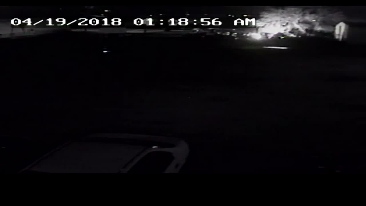 A surveillance video captured from a nearby business shows a small fire breaking out before an explosion happens.