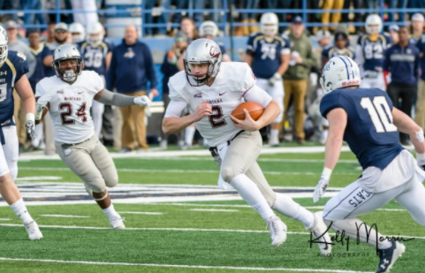 Griz QB Gresch Jensen on a keeper up the middle. (Photo courtesy: Kelly Morris Photography)
