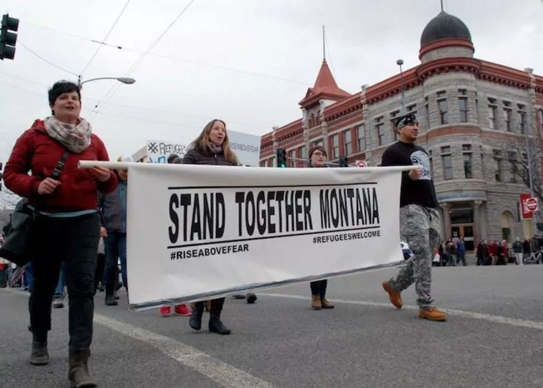 Mary Poole, left, of Soft Landing Missoula marched with refugee supporters through downtown Missoula in 2016. (Martin Kidston/Missoula Current)