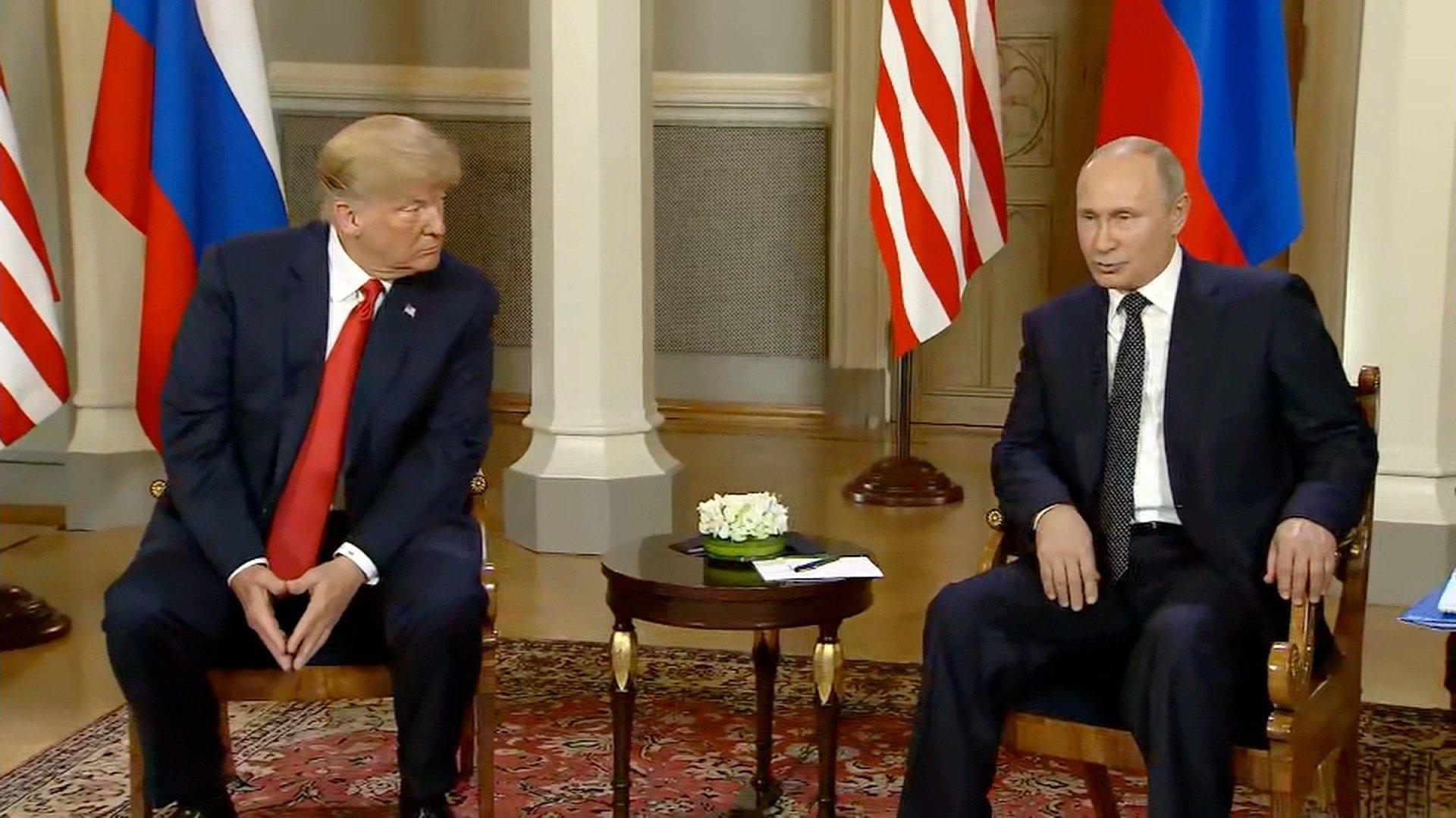 President Trump and Russian President Vladimir Putin speak at a summit in Helsinki, Finland. (POOL photo via CNN)