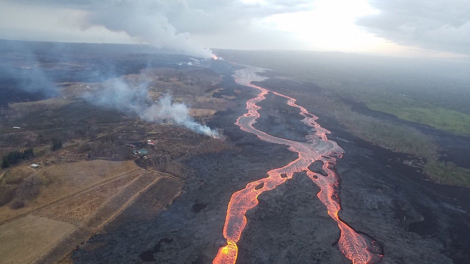 Lava flows toward the ocean in Hawaii. (Source: USGS)