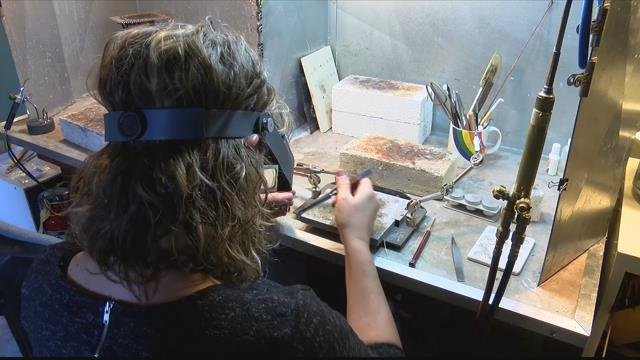 Allison Kallaway-Young who cuts, bends and hammers metals to create one-of-a-kind jewelry. (MTN News photo)
