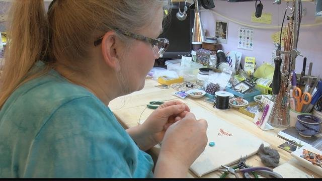 Bending, twisting, weaving and wrapping -- Lexi Butler has always had a love for designing jewelry. (MTN News photo)