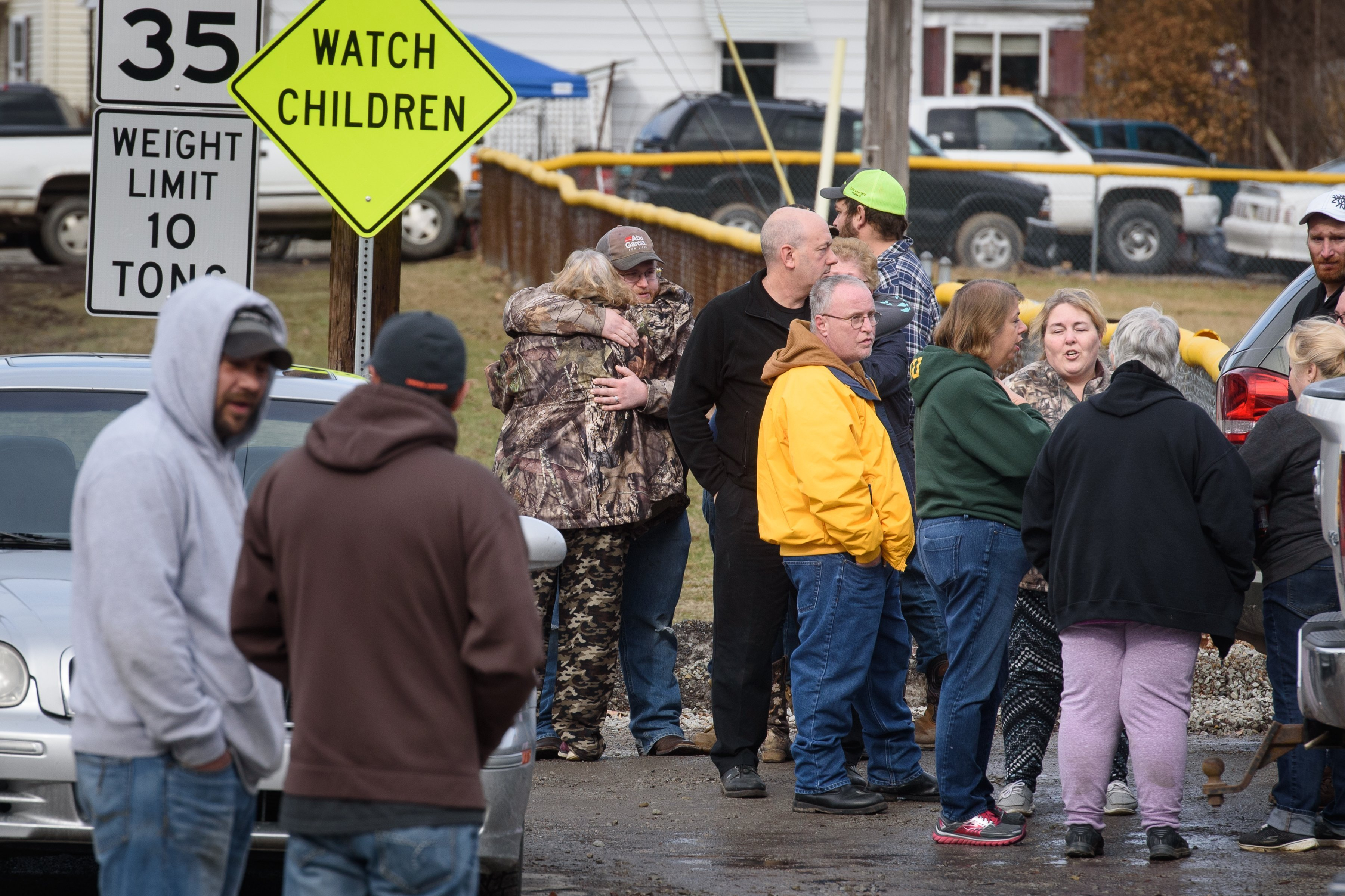 Family members and friends console each other after four people are killed at a Pennsylvania car wash. (photo credit: Getty Images North America/Getty Images via CNN)
