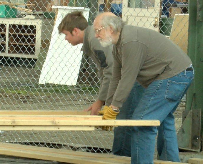Volunteers held Wood for Haiti unload lumber in Butte that will go to build a health center in Haiti (MTN News photo)